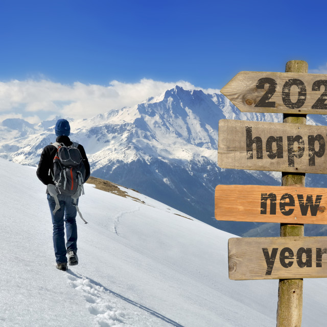 """""""2020 happy new year wrtten on a postsign with a hiker walking on"""" stock image"""