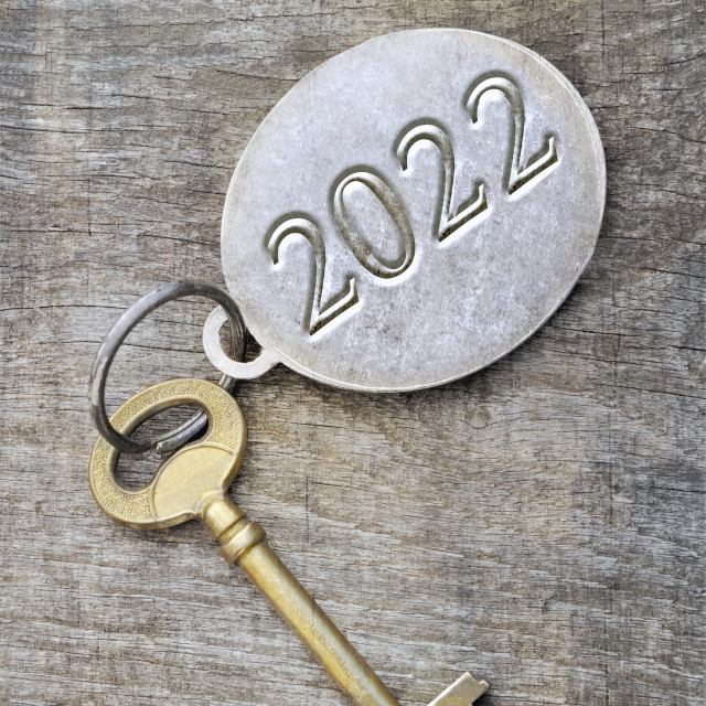 """""""2022 engraved on a ring of an old golden key on wooden background"""" stock image"""