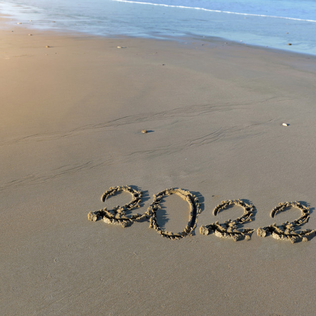 """""""2022 written on the sand to the beach"""" stock image"""