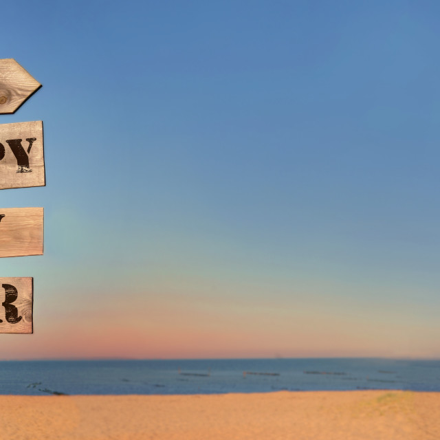 """""""2022 happy new year writing on a wooden post sign on the beach in panoramic view"""" stock image"""