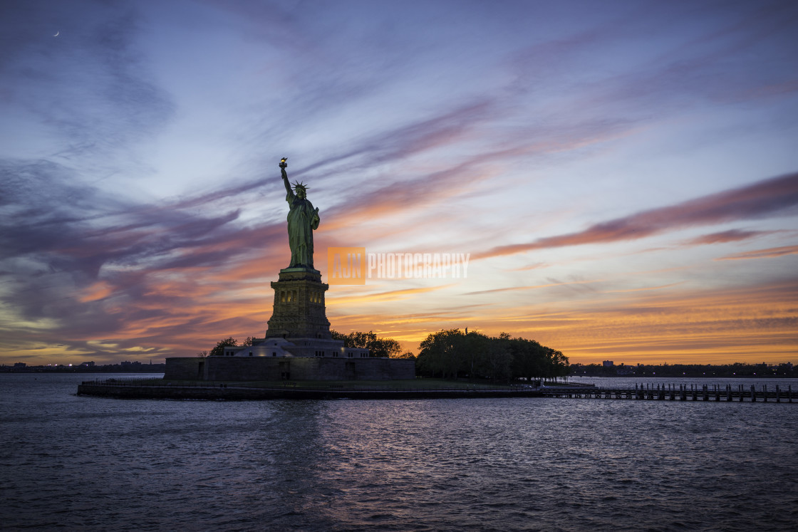 """Statue of Liberty and sunset"" stock image"