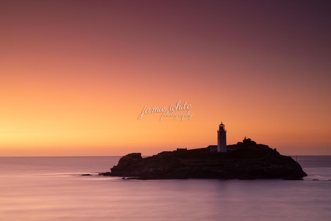 """Godrevy Lighthouse at sunset"" stock image"