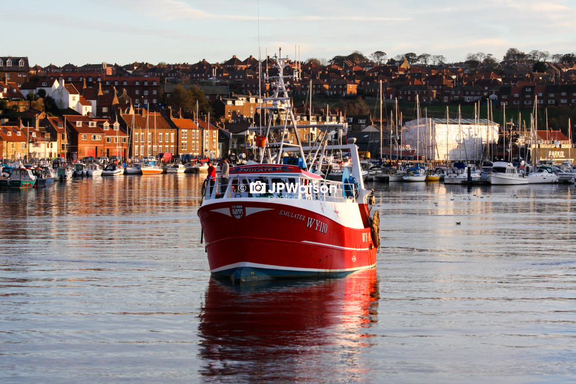 """Trawler in Whitby Harbour"" stock image"