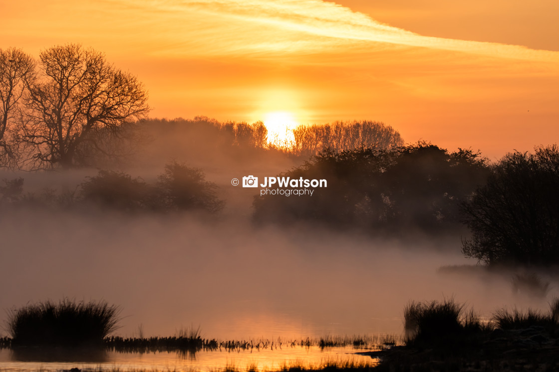 """Fantastic Sunrise over misty Lagoon"" stock image"