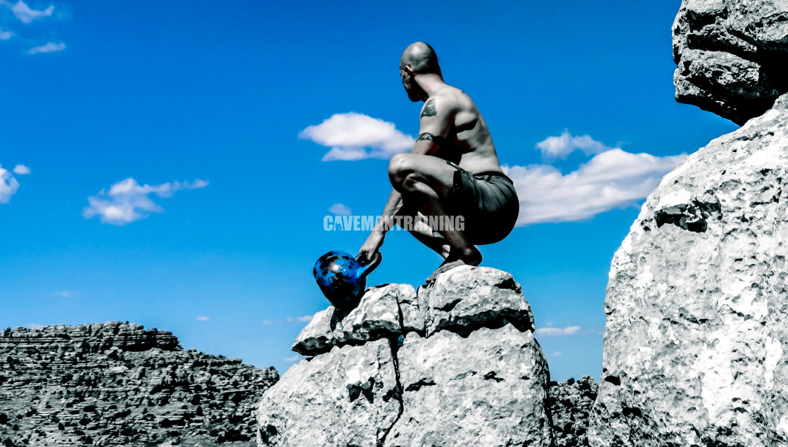 """A Man In Squat Position With Two Kettlebells"" stock image"