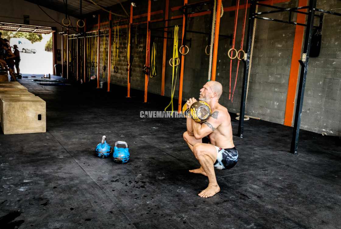"""A Man In Racked Squat Position For Squat Thrusters"" stock image"