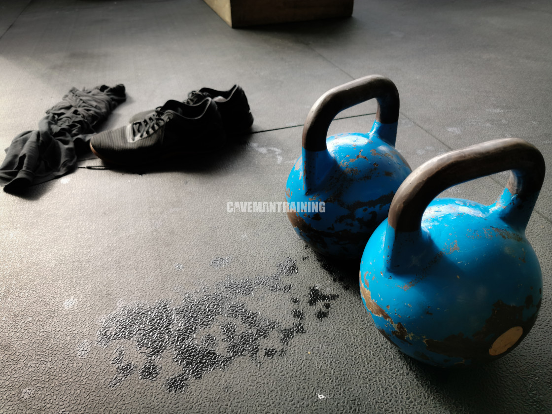 """Two Kettlebells, Shoes, and Sweaty Shirt after Workout"" stock image"