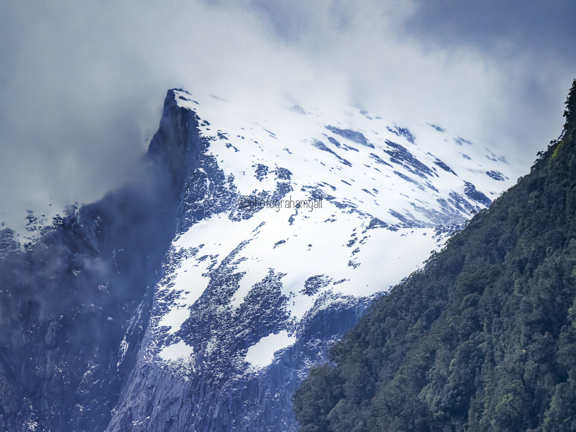 """""""Milford Sound - snow covered peaks"""" stock image"""