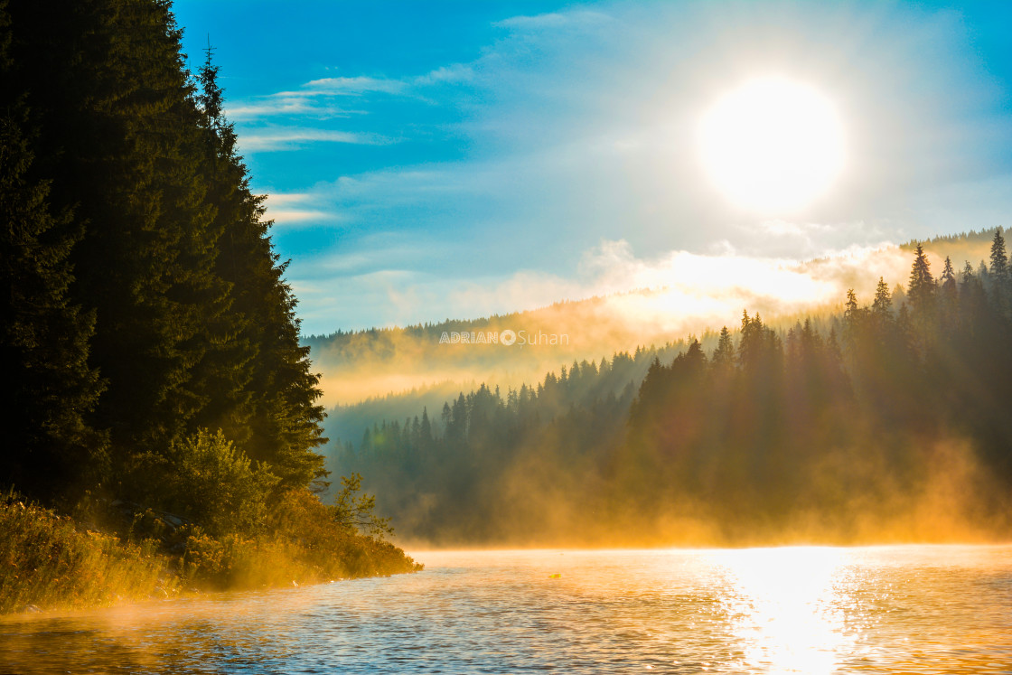 """Early morning on the lake"" stock image"