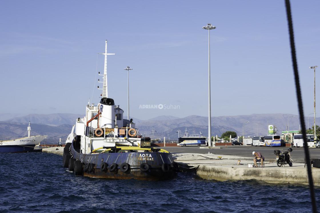 """Rusty boat in port"" stock image"