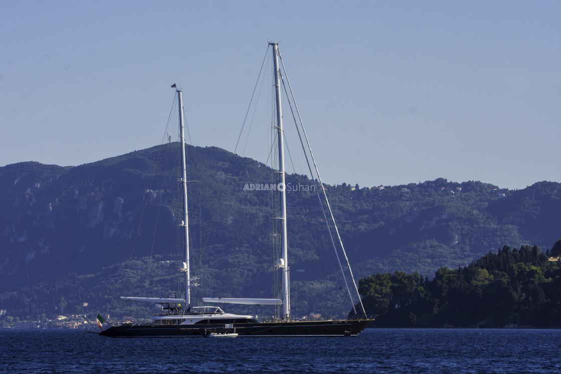 """Black boat sailing"" stock image"