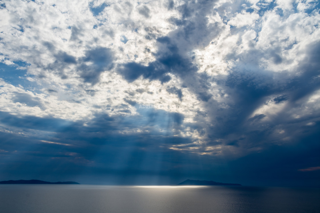 """Sunbeams through the clouds"" stock image"