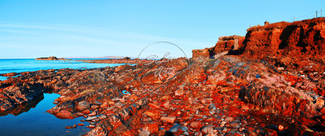 """Red Rugged Coast"" stock image"