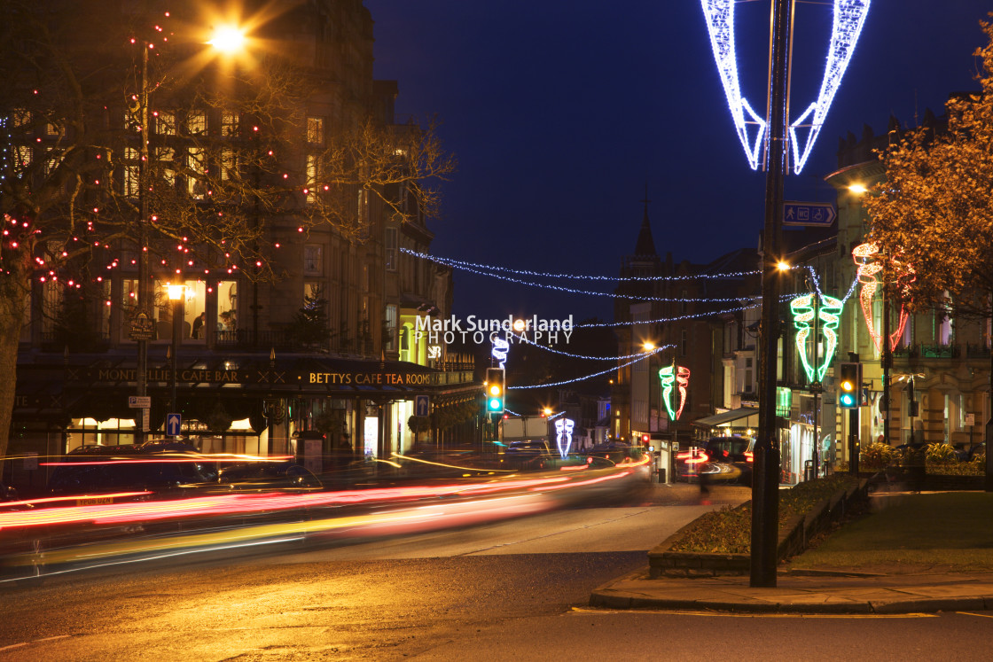 """""""Bettys and Parliament Street at Dusk Harrogate"""" stock image"""