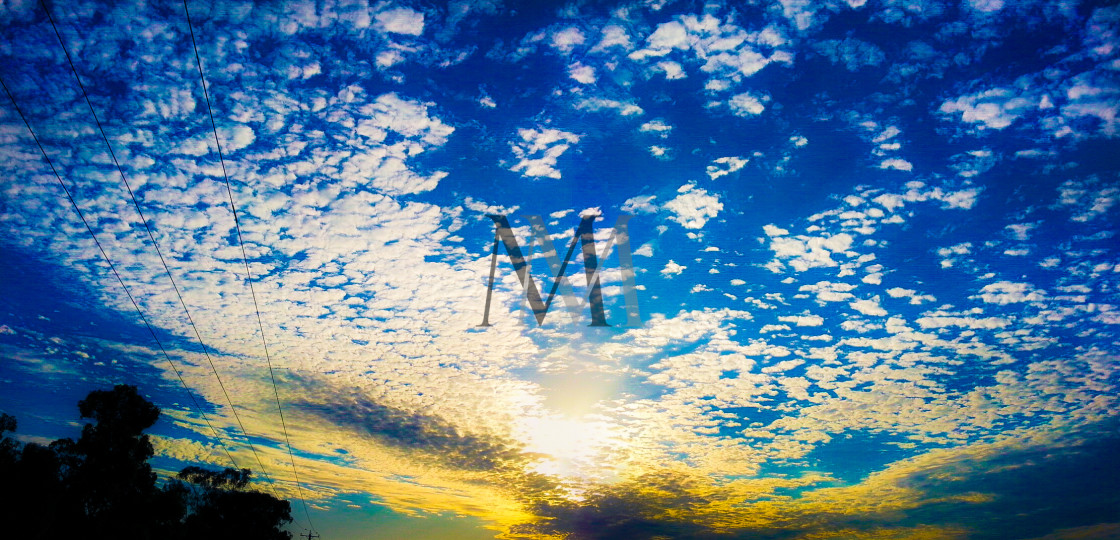 """""""Scattered Clouds"""" stock image"""