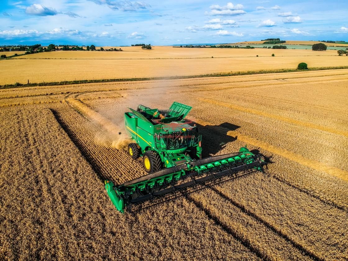 """Combine Harvester Harvesting"" stock image"