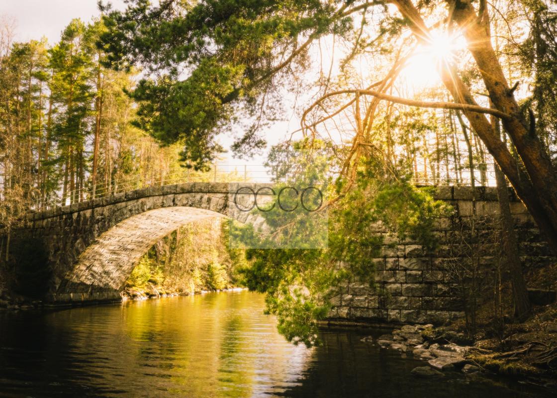 """Sunstar above a bridge"" stock image"