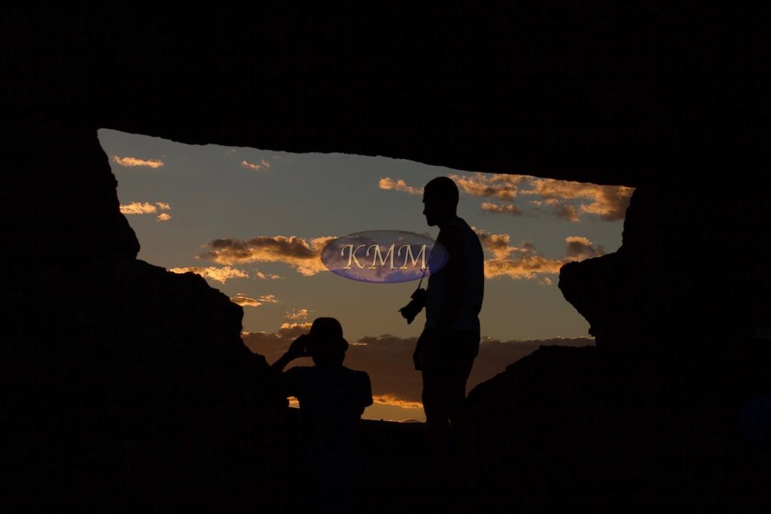 """Tourists in rock window, Isalo National Park, Madagascar"" stock image"