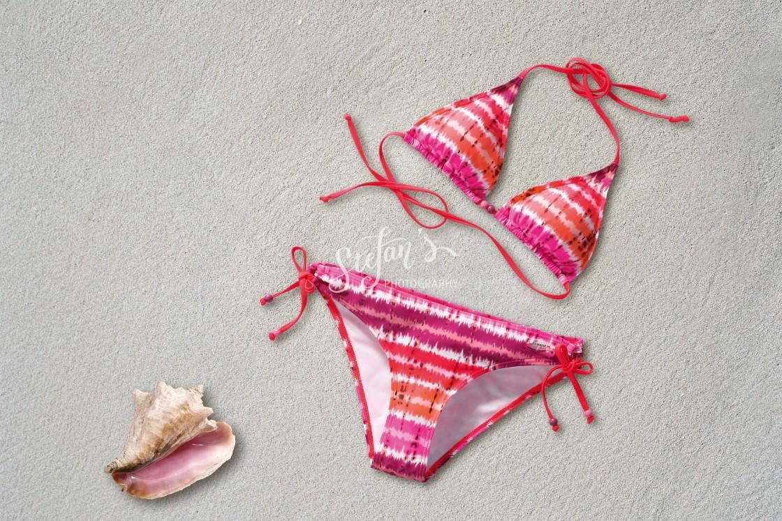 """bikini on the beach sand"" stock image"
