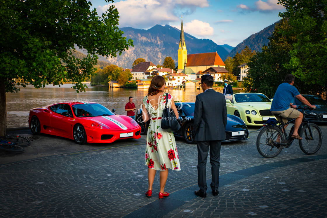 """""""Young couple in front of luxury cars"""" stock image"""