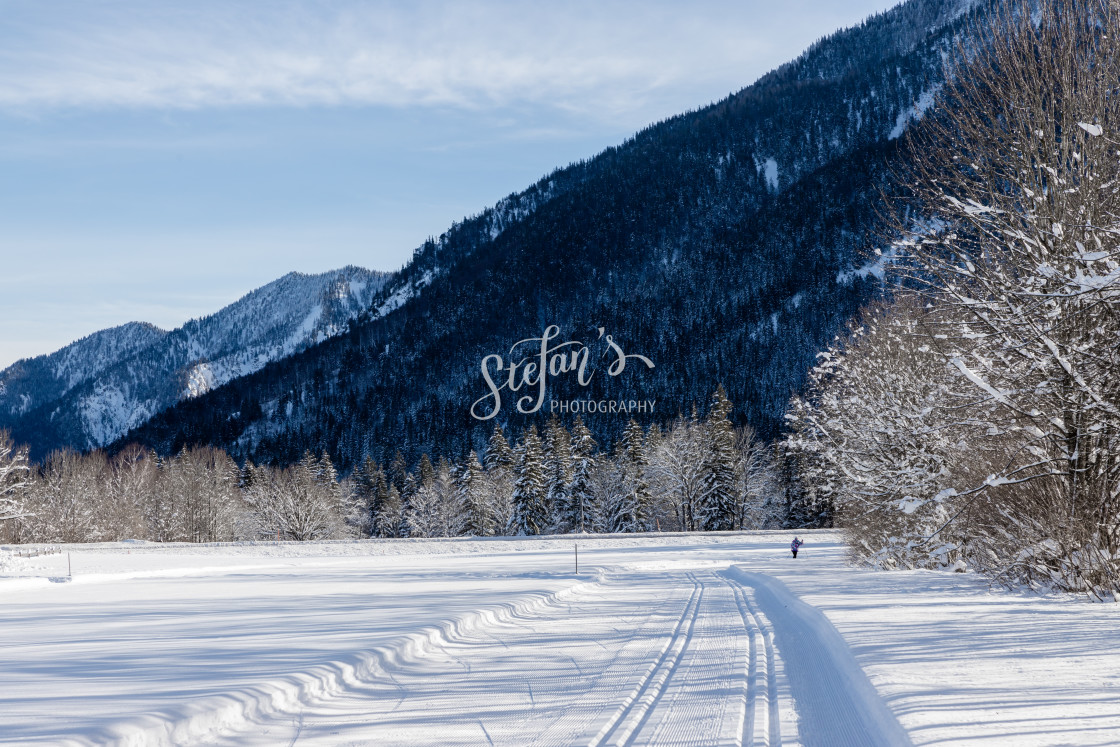 """""""Cross-country ski trail with mountains"""" stock image"""