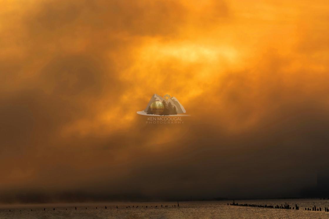 """Sunrise Through Morning Fog"" stock image"