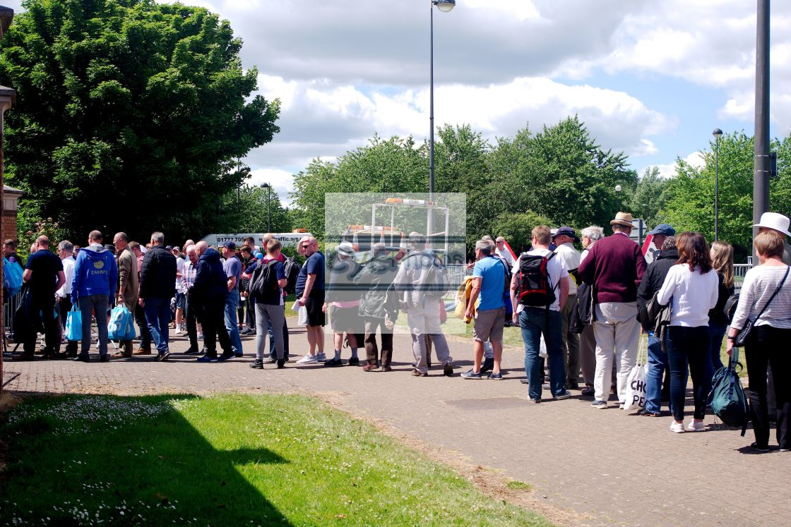 """""""Spectators queue for an event"""" stock image"""