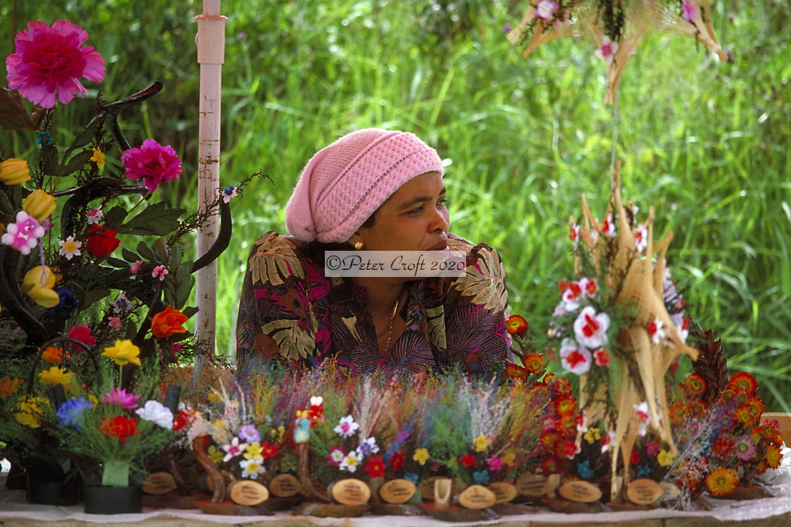 """A Malaysian flower seller waits for customers, 1986."" stock image"