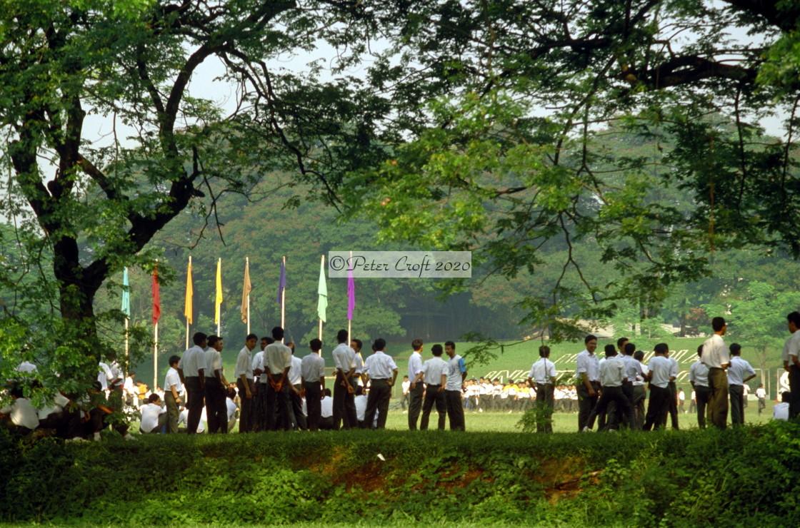 """Schoolboys at a sports ground, Kuala Lumpur, Malaysia."" stock image"