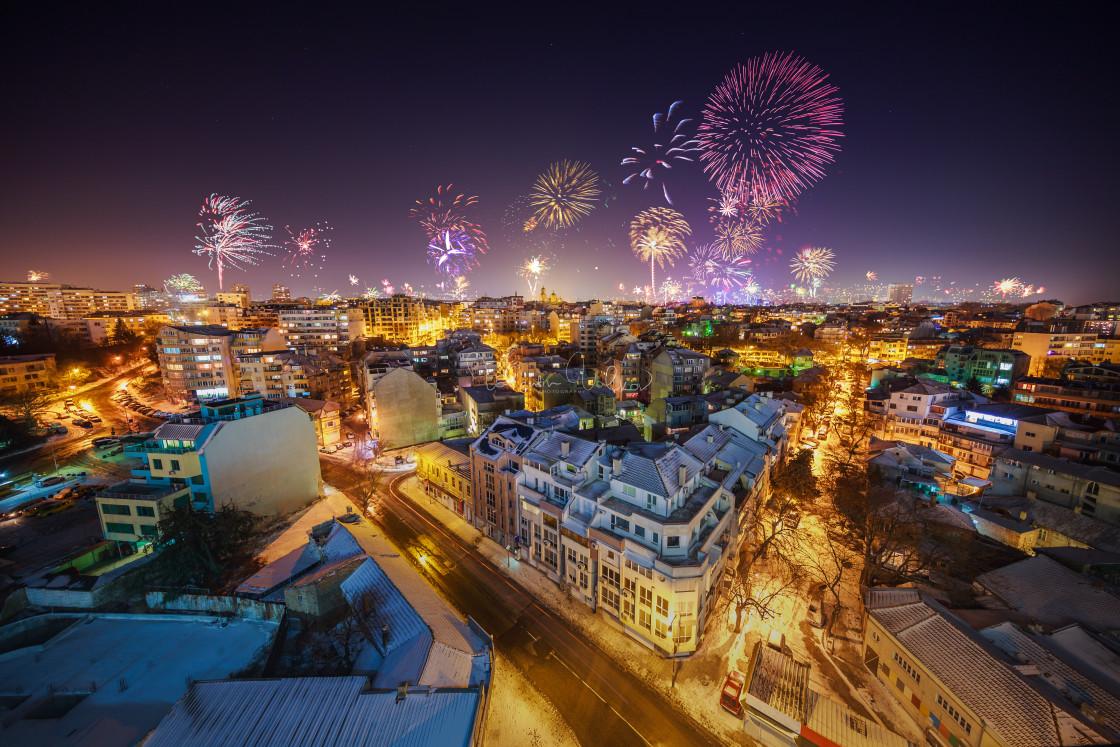 """Downtown Varna cityscape with many flashing fireworks celebratin"" stock image"