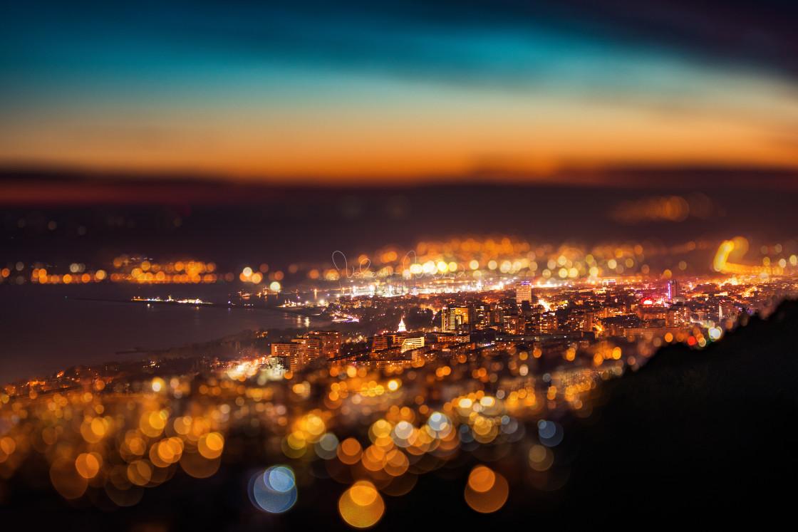 """Tilt shift blur effect. Night aerial view panorama of Varna Town"" stock image"