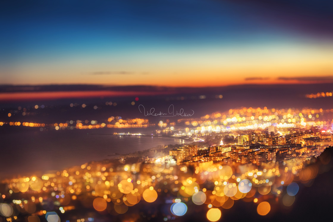 """Tilt shift blur effect. Night aerial view panorama of Varna Town"" stock image"