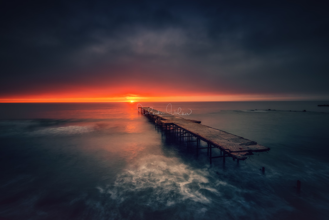 """Old broken bridge in the sea, long exposure"" stock image"