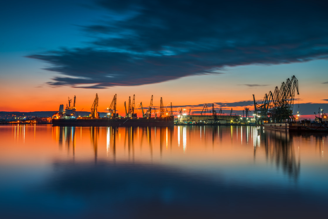 """Sunset over sea port and industrial cranes, Varna"" stock image"