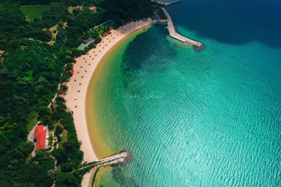 """""""Aerial drone view of a beautiful beach with white sand and umbre"""" stock image"""