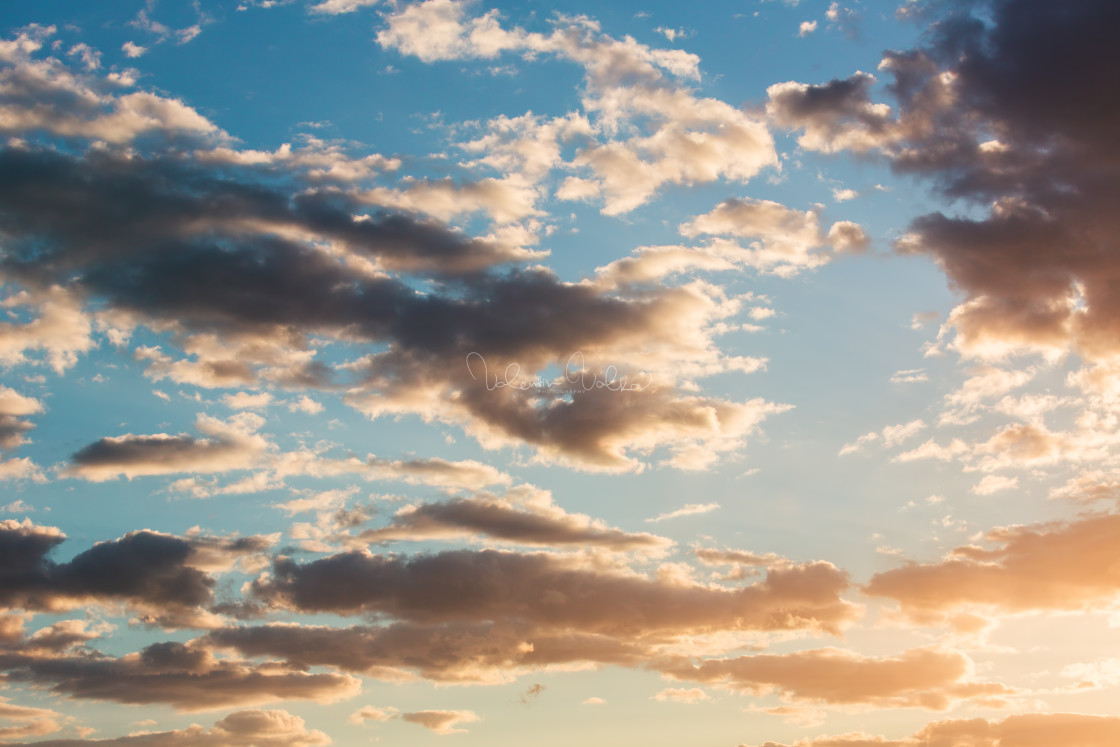 """Sunset dramatic sky clouds with sunbeam"" stock image"
