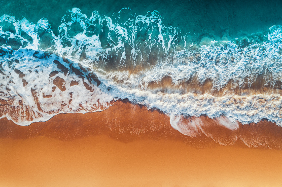 """Aerial view of sea waves and sandy beach"" stock image"