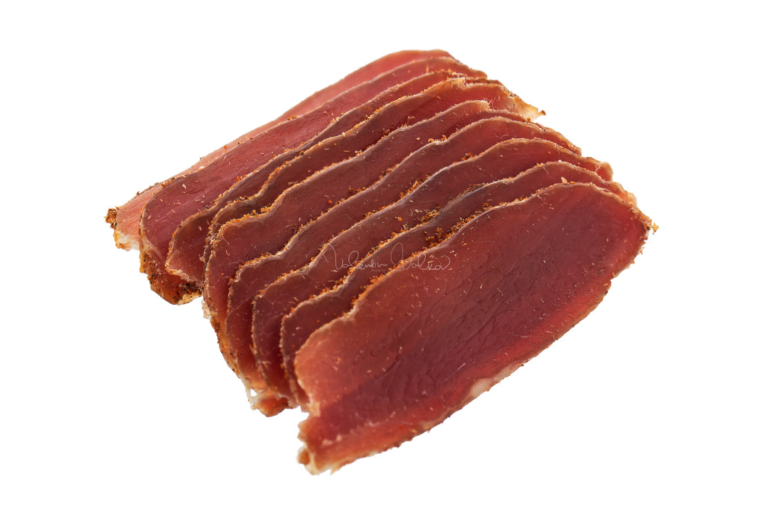 """Basturma, dried tenderloin of beef meat, thinly sliced, on a whi"" stock image"