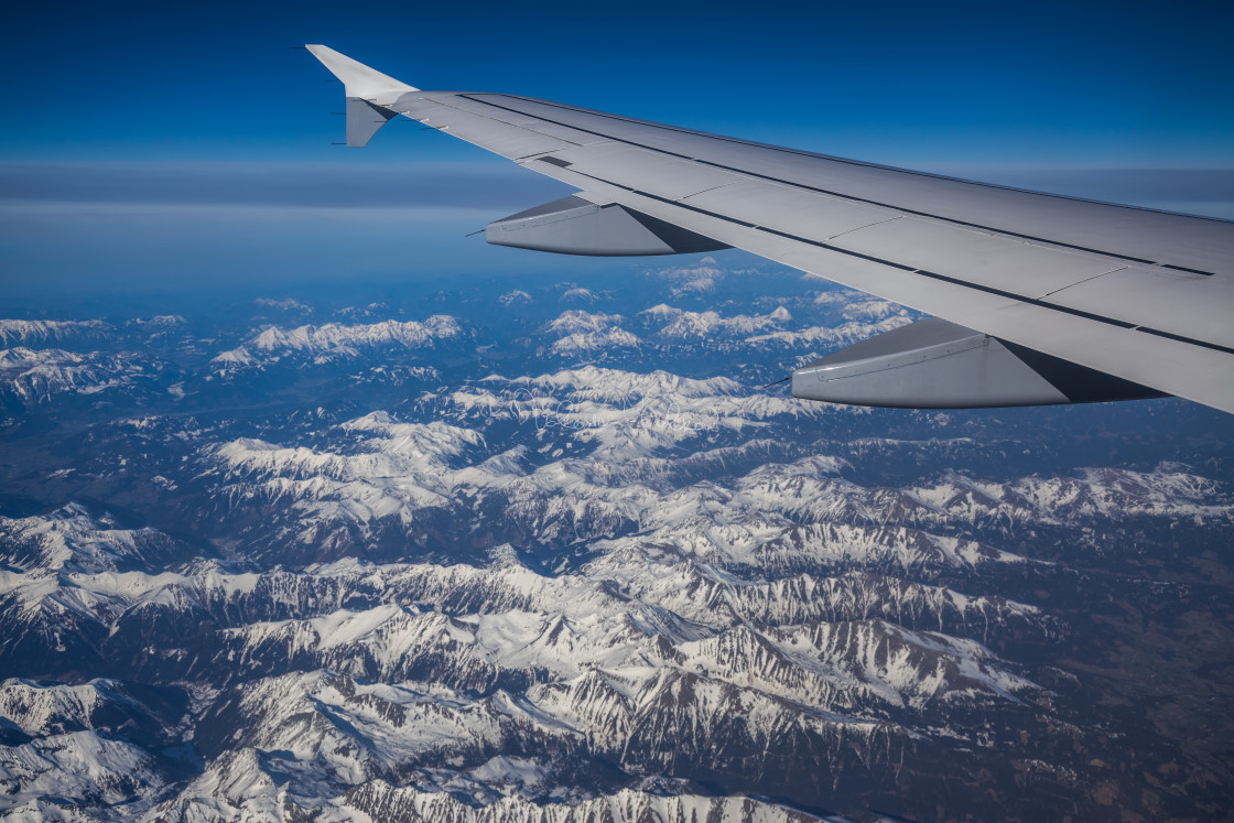 """""""Aerial vew from the airplane at Alps under snow"""" stock image"""