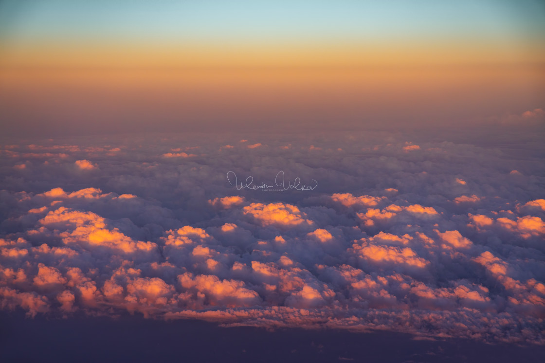 """""""Aerial view from the plane over fluffy clouds"""" stock image"""