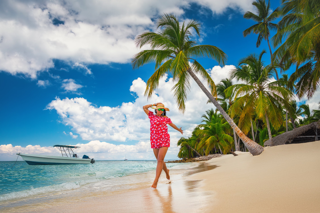 """Carefree young woman relaxing on tropical beach"" stock image"