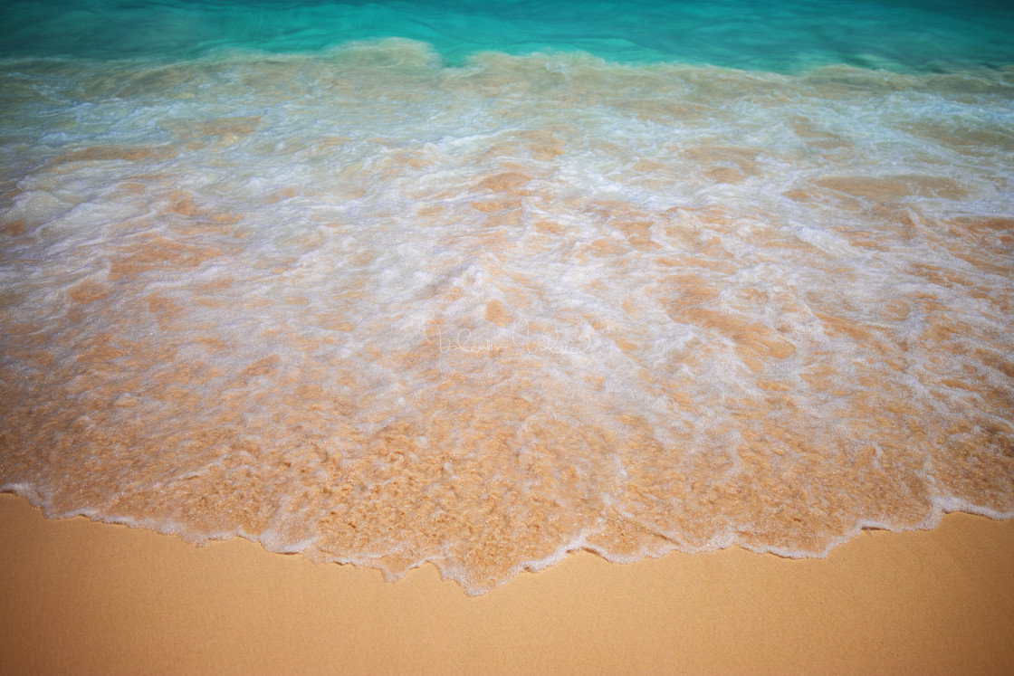 """Soft wave of blue ocean on sandy beach."" stock image"