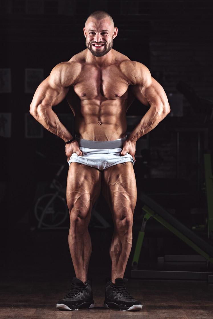 """""""Strong bodybuilder athletic man pumping up muscles workout bodyb"""" stock image"""