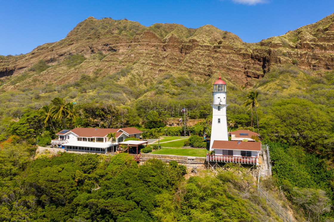 """""""View of Diamond Head lighthouse from the ocean in Hawaii"""" stock image"""