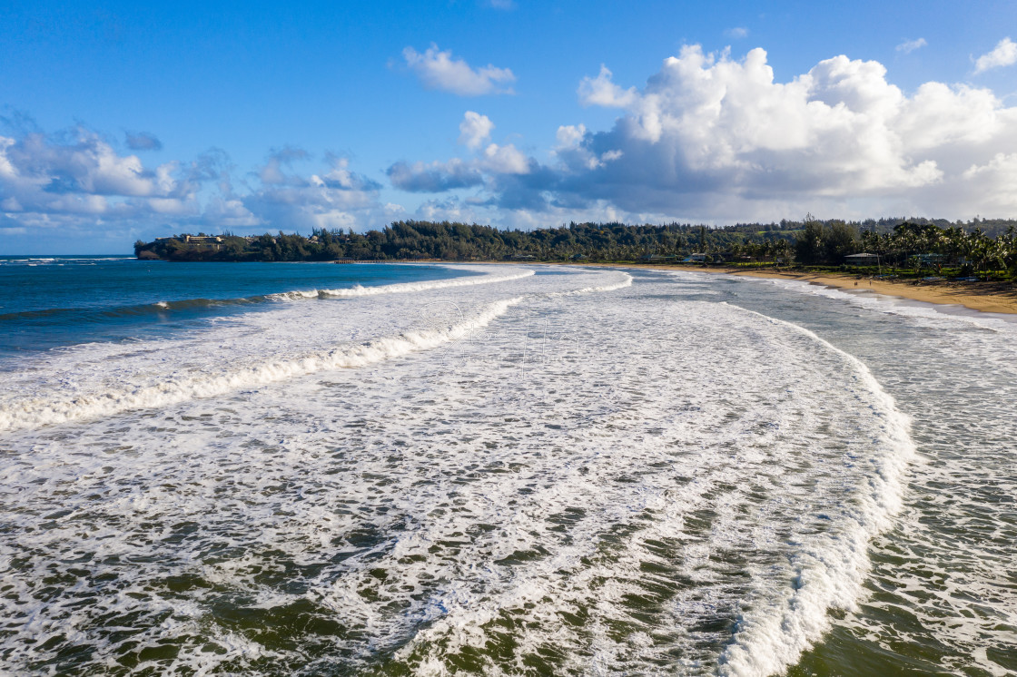 """""""Aerial drone shot of Hanalei bay and Princeville from Waioli beach park"""" stock image"""