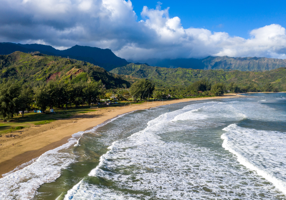 """""""Aerial drone shot of Hanalei bay and mountains from Waioli beach park"""" stock image"""