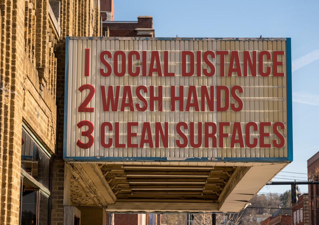 """Recommendations for avoiding Coronavirus on downtown Main Street cinema"" stock image"