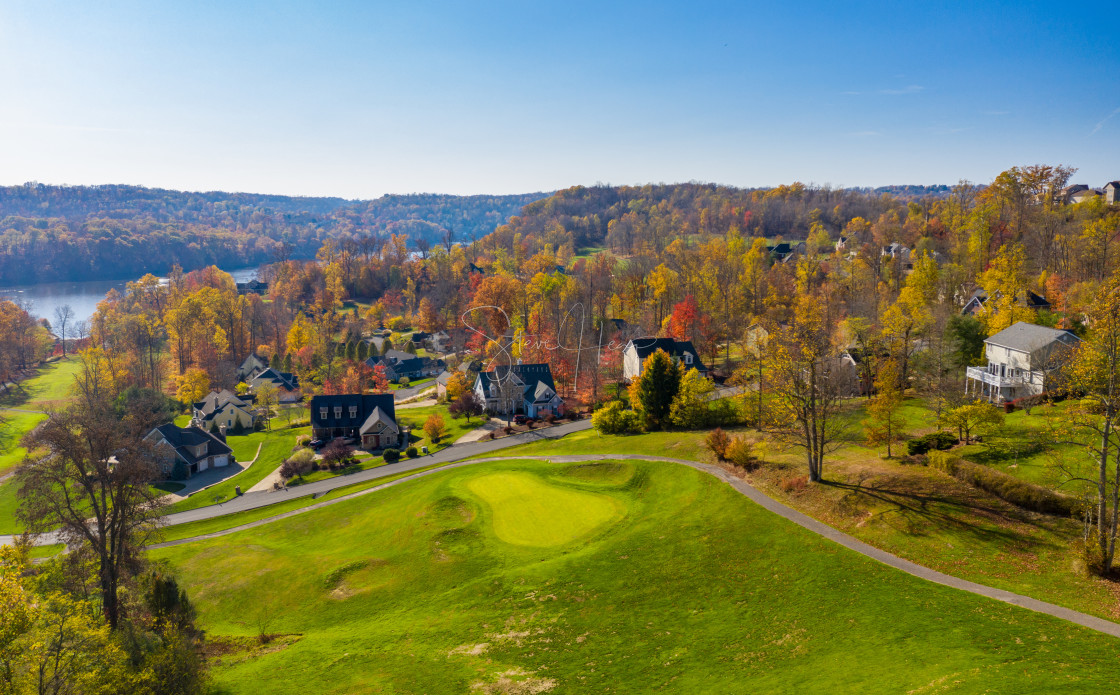 """""""Aerial view of single family homes in a golf community in the fall outside..."""" stock image"""
