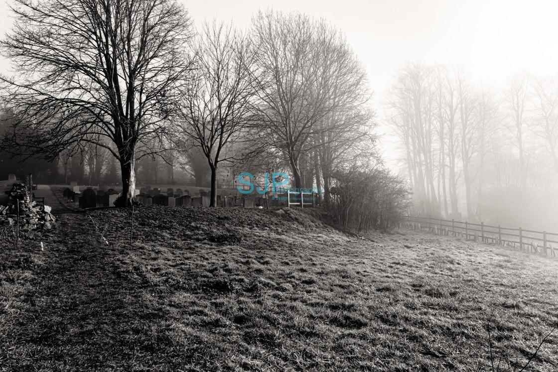 """St Mary's Churchyard Garsington Moody Greyscale"" stock image"