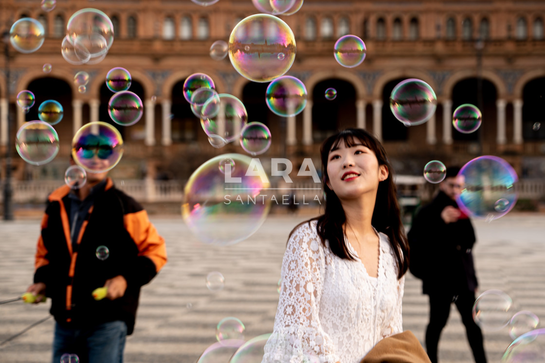 """Happy among the bubbles"" stock image"